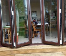 https://www.cdwsystems.co.uk/wp-content/uploads/2017/06/Aluk-rosewood-bifold-door.jpg